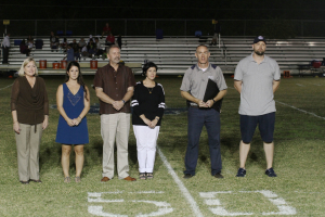 Merritt Island Christian School - Senior Night Half Time Presents the Foundation with a Plaque on 10/29/15
